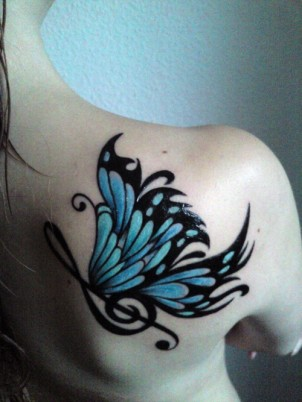 a big blue butterfly on a girl's back / shoulder