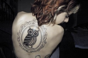 Black locket style owl back tattoo