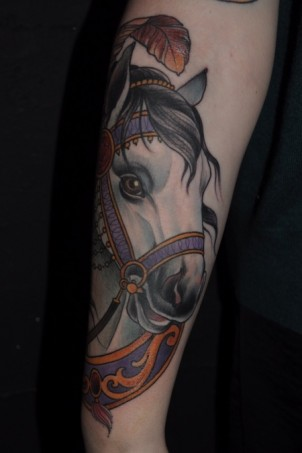 Beautiful white horse half-sleeve on girls arm