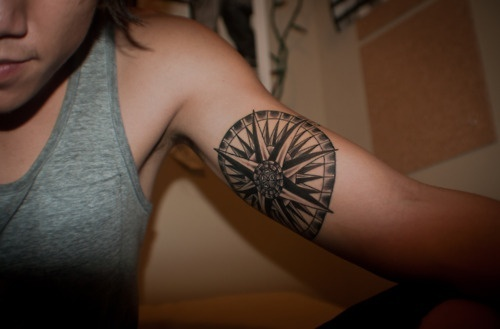 black and white nautical compass on girls arm