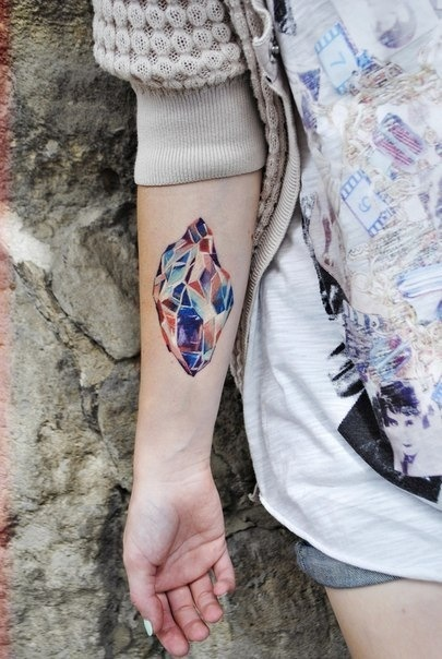 Crystal tattoo using stunning colors on girls arm
