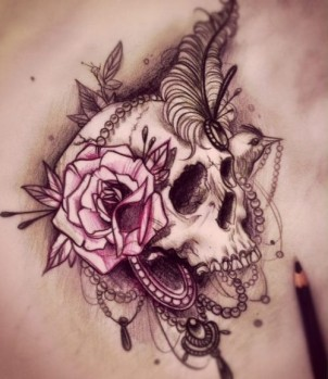 Skull design with old school head dress of flowers, feathers, and jewlery