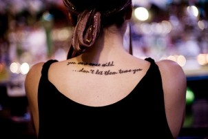 """You were once wild …don't let them tame you"" quote tattoo on girls back"