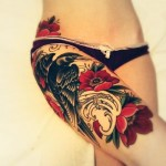 Girls bird perched on roses tattoo on her lrg