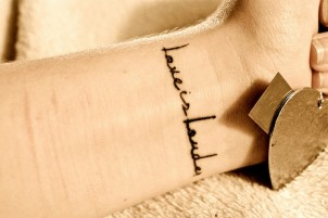 love is louder wrist tattoo