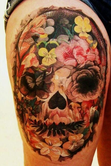 Super nice skull made of flowers tattoo on girls leg