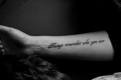 """Always remember who you are"" quote tattoo on girls arm"