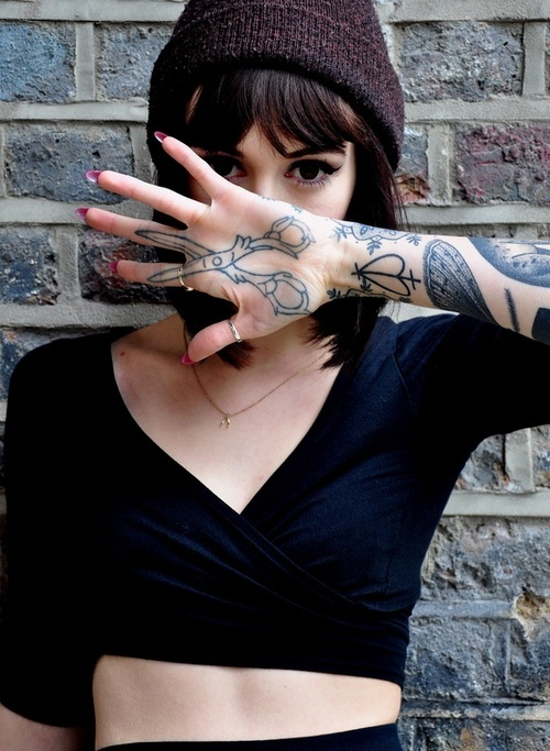 Girl's scissors tattoo on her hand