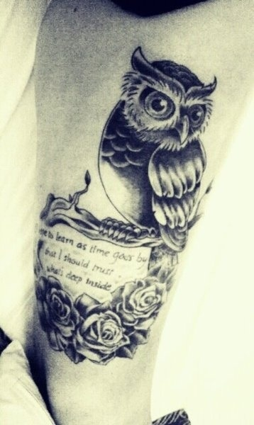 Owl tattoo with quote and roses on girls leg