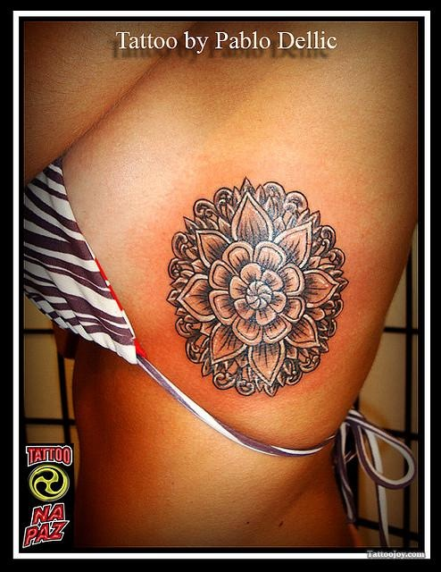 big lotus flower tattoo on girls side