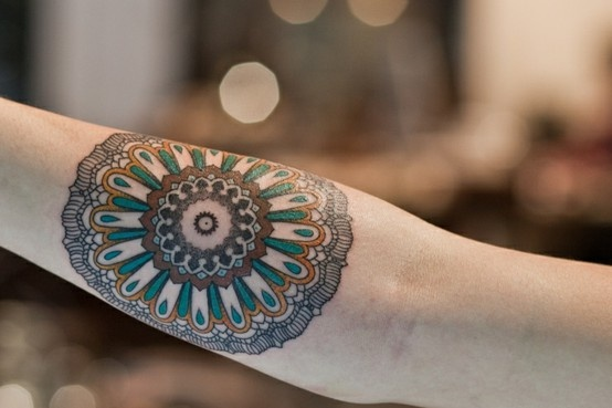 Girls round geometric patterns arm tattoo