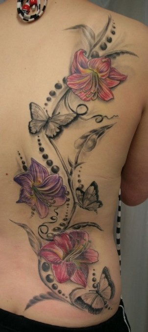 colorful lillies and black butterflies on right side of girls back