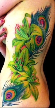 vibrant peacock feathers and tiger lillies tattoo