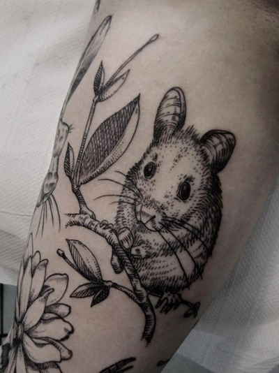 Lithograph-style field mouse tattoo on girls arm